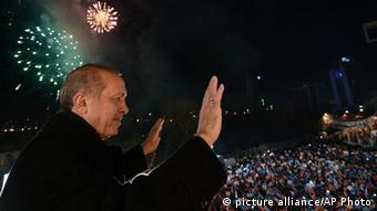 Erdogan with fireworks in the background