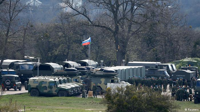 Russian troops and vehicles are seen at a military base in Perevalnoye, near the Crimean city of Simferopol, March 27, 2014. (photo:REUTERS/Shamil Zhumatov)