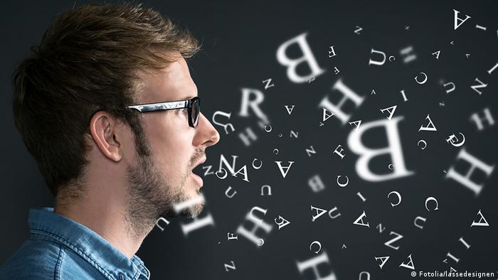 A man and symbolic letters on a blackboard, Copyright: Fotolia
