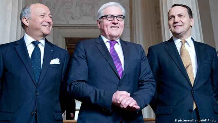French Foreign Minister Laurent Fabius, German Foreign Minister Frank-Walter Steinmeier and Polish Foreign Minister Radoslaw Sikorski, from left to right, stand in the foyer prior to their Weimar Triangle meeting in Weimar, Germany, Tuesday, April 1, 2014. AP Photo/Jens Meyer