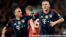 Bayern Munich's German midfielder Bastian Schweinsteiger (R) celebrates with Bayern Munich's French midfielder Franck Ribery (L) after scoring his team's first goal to equalise during the UEFA Champions League quarter-final first leg football match between Manchester United and Bayern Munich at Old Trafford in Manchester on April 1, 2014. AFP PHOTO / CHRISTOF STACHE (Photo credit should read CHRISTOF STACHE/AFP/Getty Images)