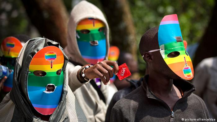 Demonstrators with rainbow-colored masks