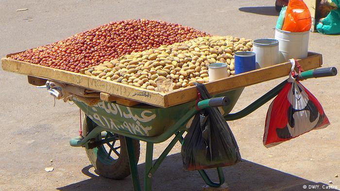 A wooden board on a wheelbarrow serves as a seed seller's cart in the Sudanese capital Khartoum
