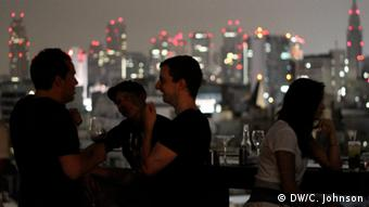 White, educated residents of Japan at a stylish Tokyo club.