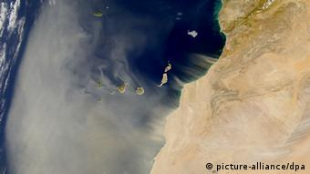 A satellite image of Sahara dust blowing over an ocean