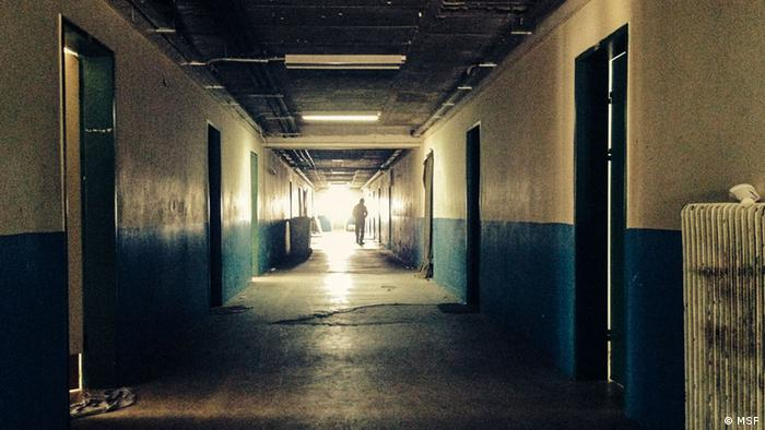 A picture of a hallway from Komitini detention center in Greece. The subject of the MSF report.