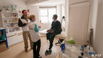 A picture of a migrant undergoing a medical consultation with MSF doctors in Greece.