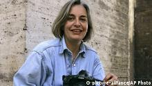 HANDOUT - FILE - In this Thursday, April 2005 file photo, Associated Press photographer Anja Niedringhaus poses for a photograph in Rome. Niedringhaus, 48, was killed and an AP reporter was wounded on Friday, April 4, 2014 when an Afghan policeman opened fire while they were sitting in their car in eastern Afghanistan. Niedringhaus an internationally acclaimed German photographer, was killed instantly, according to an AP Television freelancer who witnessed the shooting. Kathy Gannon, the reporter, was wounded twice and is receiving medical attention. AP Photo/Peter Dejong/dpa