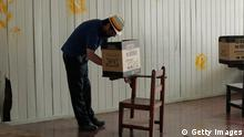 A man casts his ballot for a presidential election runoff at a polling station during the presidential elections in San Jose April 6, 2014. Luis Guillermo Solis, a center-left academic who has never been elected to office, is expected to easily win Costa Rica's presidential election run-off today, after his ruling party rival unexpectedly ditched his bid last month. REUTERS/Juan Carlos Ulate (COSTA RICA - Tags: ELECTIONS POLITICS)