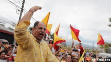 Luis Guillermo Solis, presidential candidate of the Citizens' Action Party (PAC), gestures to supporters after casting his ballot at a voting station during Costa Rica's presidential election run-off in San Jose March 6, 2014. A centre-left academic who has never been elected to office is expected to cruise to victory in Costa Rica's presidential election run-off on Sunday after his ruling party rival pulled out. Solis, a former diplomat, rode a wave of anti-government sentiment over rising inequality and corruption scandals to finish ahead in a first round of voting in February, surprising pollsters who had placed him fourth. REUTERS/Juan Carlos Ulate (COSTA RICA - Tags: ELECTIONS POLITICS)