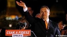 Hungary's Prime Minister Viktor Orban waves hand as he addresses to supporters after partial results of parliamentary elections are announced in Budapest April 6, 2014. Hungarians have handed Orban another four years in power, early results showed from a parliamentary election on Sunday that also entrenched the far-right Jobbik party as a major political force. A partial tally released by election officials, based on a count of about a quarter of the ballots cast, gave Orban's Fidesz party 48.2 percent of the vote. REUTERS/Laszlo Balogh (HUNGARY - Tags: POLITICS ELECTIONS)