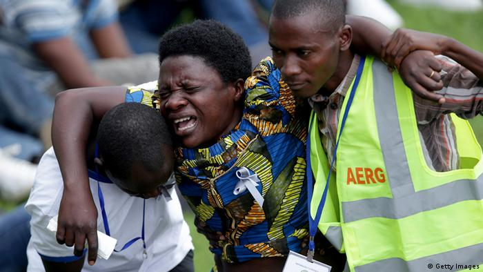 A Rwandan woman weeps during the genocide commemoration