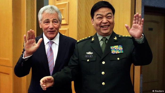 U.S. Defense Secretary Chuck Hagel (L) and his Chinese counterpart Chang Wanquan wave to members of the media prior to their meeting at the Chinese Defense Ministry headquarters in Beijing April 8, 2014.
