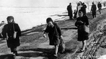 Children walking from a Polish internment camp to a German refugee camp