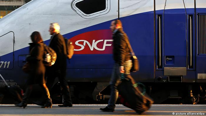 Passengers in front of a SNCF train in Lyon