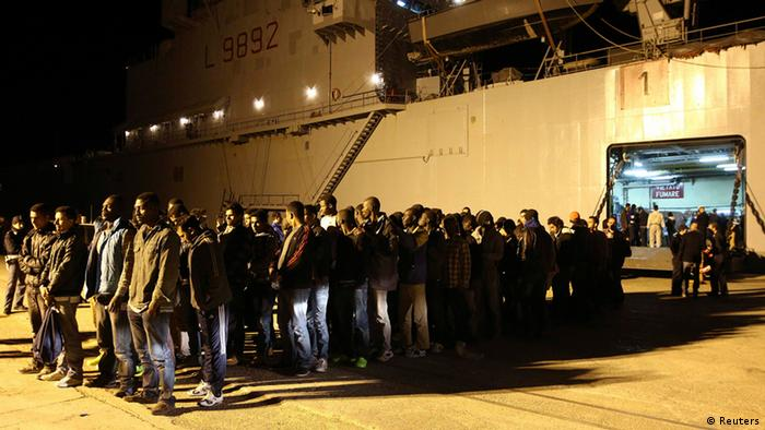 Migrants stand in line at the Sicilian harbour of Augusta April 9, 2014. Italy has rescued 4,000 migrants from boats trying to reach European shores in the past 48 hours in a deepening immigration crisis, the interior minister said on Wednesday (Photo: REUTERS/Antonio Parrinello)