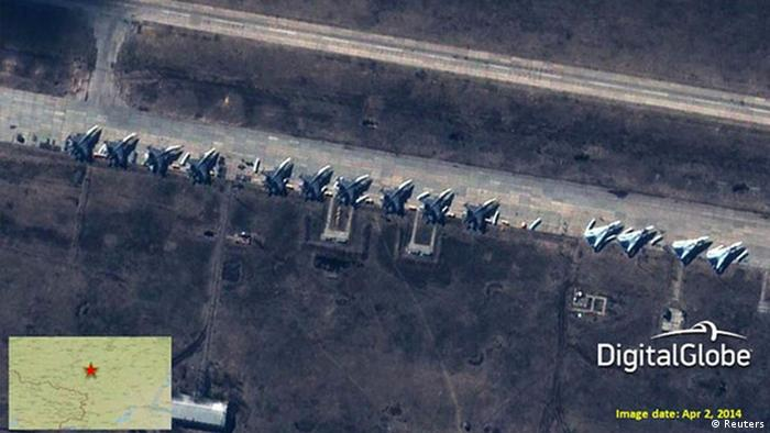 A satellite image provided to Reuters by Supreme Headquarters Allied Powers Europe (SHAPE) on April 10, 2014 and taken by DigitalGlobe on April 2, 2014 shows what is reported by SHAPE to be Russian Su-27/30 Flankers and Su-24 Fencers at a military base in Buturlinovka, southern Russia.