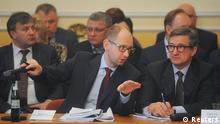 Ukraine's Prime Minister Arseny Yatseniuk (L, front) talks to Donetsk region Governor Serhiy Taruta (R, front) during a meeting in Donetsk, April 11, 2014. REUTERS/Andrew Kravchenko/Pool (UKRAINE - Tags: POLITICS)