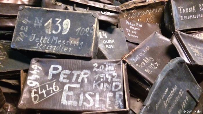 Museum showcase with Auschwitz prisoners' suitcases