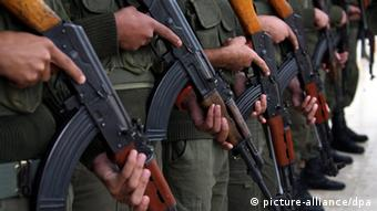 symbolic Picture Shows army People Holding big guns