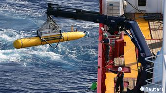 The Bluefin-21 Autonomous Underwater Vehicle is craned over the side of the Australian Defence Vessel Ocean Shield in the southern Indian Ocean during the continuing search for the missing Malaysian Airlines flight MH370 in this picture released by the Australian Defence Force April 17, 2014.