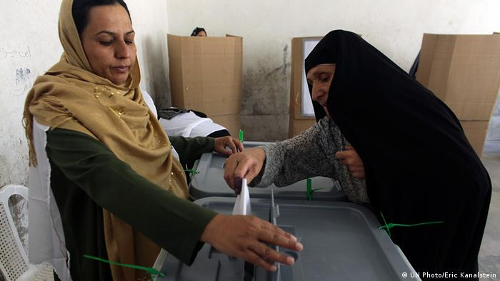 Election monitoring in Afghanistan. A woman casts her ballot. (Photo: UN Photo/Eric Kanalstein)