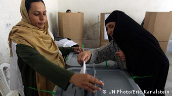 Woman voting at an Afghan polling station
