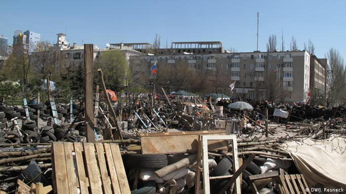 Barricades made of tires, razor wire and pallets in Donetsk, Ukraine