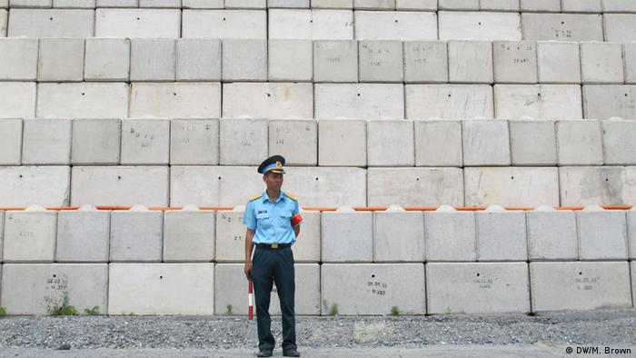 A soldier guards the site of the Agent Orange remediation project in Danang