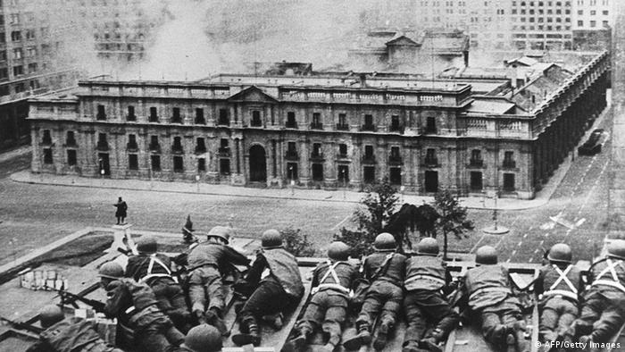 Chilean troops under General Pinochet's command storm the presidential palace. (AFP/Getty Images)
