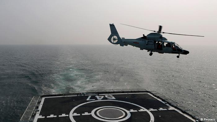 A Chinese naval helicopter takes off from Chinese naval frigate Linyi during multi-country maritime joint exercises off the coast in Qingdao, Shandong province April 23, 2014. The Chinese People's Liberation Army (PLA) Navy organized its first multilateral maritime exercises, dubbed Maritime Cooperation - 2014, off the coast of the eastern Chinese city Qingdao on Wednesday, where 19 ships, seven helicopters and marine corps from eight countries including China, Bangladesh, Pakistan, Singapore, Indonesia, India, Malaysia and Brunei took part in the drills, Xinhua News Agency reported.