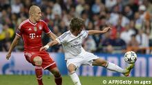 Real Madrid's Portuguese defender Fabio Coentrao (R) vies with Bayern Munich's Dutch midfielder Arjen Robben during the UEFA Champions League semifinal first leg football match Real Madrid CF vs FC Bayern Munchen at the Santiago Bernabeu stadium in Madrid on April 23, 2014. AFP PHOTO/ DANI POZO (Photo credit should read DANI POZO/AFP/Getty Images)