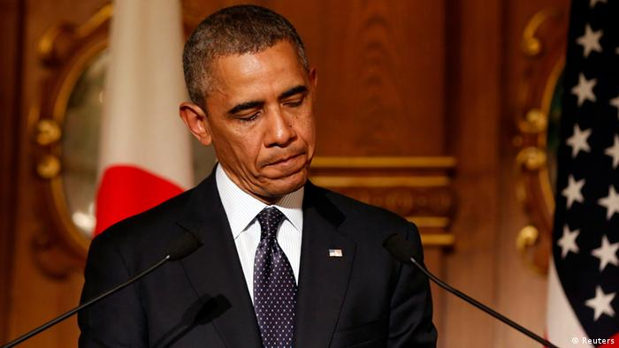 Obama frowning Photo: REUTERS/Larry Downing