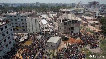 Crowds gather round the collapsed Rana Plaza building