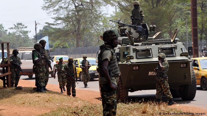 Burundian soldiers on foot and riding a tank secure a street. Photo: SIA KAMBOU/AFP/Getty Images