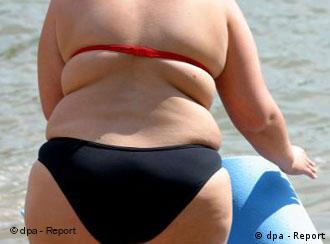 Obese woman on a beach