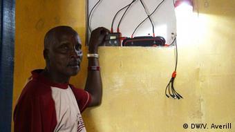 Daniel Tempes Olonapa with his solar console box