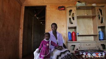 Anne Wanjiku with her daughter in their home