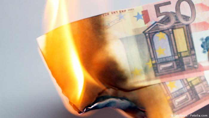 A burning euro note