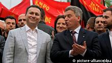 epa04180009 Nikola Gruevski (L), leader of the ruling VMRO DPMNE and current Prime Minister and his Presidential candidate and current President Gjorge Ivanov (R), greet their supporters during the last party's election rally in Veles, The Former Yugoslav Republic of Macedonia, 25 April 2014. The citizens of FYR of Macedonia will vote on parliamentary elections and the second round of the presidential polls, on Sunday 27 April 2014. EPA/GEORGI LICOVSKI