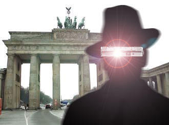 The symbolic silhouette of a spy in front of Brandenburg Gate