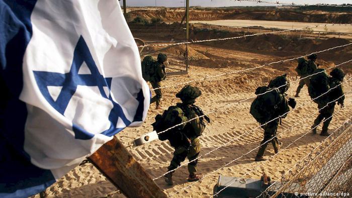 Israeli soldiers beside the Gaza Strip border