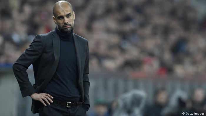Pep Guardiola looks dejected after seeing his side lose to Real.