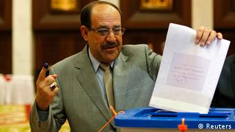 Iraq's Prime Minister Maliki turning in his ballot