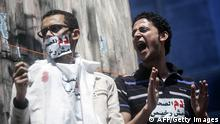 Journalists and photojournalists shout slogans as they demonstrate against repeated attacks on members of the press on April 17, 2014 in front of the building of the Press Syndicate in Cairo. The union asked the journalists working in Egypt to go on strike to ask for guarantee of safety and security while doing their jobs as they have faced an increasing amount of violence in recent years while covering protests and clashes. AFP PHOTO / MAHMOUD KHALED (Photo credit should read MAHMOUD KHALED/AFP/Getty Images)