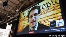 AUSTIN, TX - MARCH 10: NSA whistleblower Edward Snowden speaks via videoconference at the 'Virtual Conversation With Edward Snowden' during the 2014 SXSW Music, Film + Interactive Festival at the Austin Convention Center on March 10, 2014 in Austin, Texas. (Photo by Michael Buckner/Getty Images for SXSW)