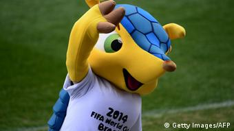 Fuleco, Brazil's 2014 World Cup mascot, waves. (Photo: JAVIER SORIANO/AFP/Getty Images)