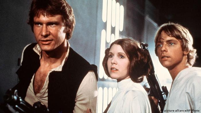 Harrison Ford, as Han Solo, Carrie Fisher, as Princess Leia Organa, and Mark Hamill, as Luke Skywalker in a scene from the 1977 Star Wars