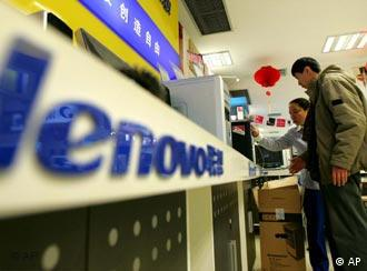 A customer looks at Lenovo computers in a department store in Beijing Thursday March 24, 2005. Chinese computer maker Lenovo on Thursday refused to comment on reports that several U.S. private equity firms are close to buying stakes in the company worth a total US$350 million (Euro 270 million). (AP Photo/Greg Baker)
