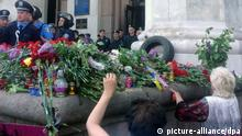 ITAR-TASS: ODESSA, UKRAINE. MAY 3, 2014. People lay flowers at the regional Trade Unions House to pay tribute to those who died in trade union building fire and riots in Odessa on May 2, 2014. (Photo ITAR-TASS/ Alexander Gagarin)